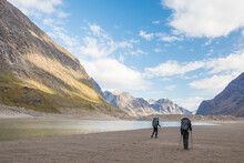 Rear View Of Two Men Hiking In Akshayak Pass, Auyuittuq National Park