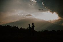 Silhoutte Of Two Lover Sunset In The Mountains