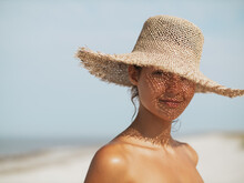Beach Woman In Sun Hat On Vacation