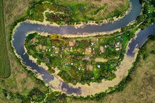 Aerial View Of Summer Cottages Surrounded By A Winding Lake. Old Lake Ogublyanka, Kaluzhskiy Region, Russia