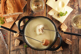 cheese fondue with bread and wine