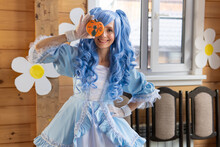 Beautiful Woman With Blue Wig In A Dress In The House.