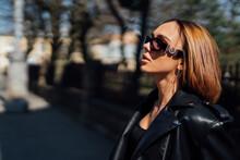 Amazing Joyful Pretty Girl Posing Outdoor. Leather Jacket,brunette Hair, Bright Red Lips Close Up Fashion Street Stile Portrait Model Looking Aside