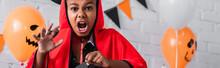 Spooky African American Boy In Devil Halloween Costume Screaming, Banner