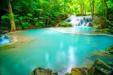 Waterfalls And Fish Swim In The Emerald Blue Water In Erawan National Park. Erawan Waterfall Is A Beautiful Natural Rock Waterfall In Kanchanaburi, Thailand.Onsen Atmosphere. Soft Focus.