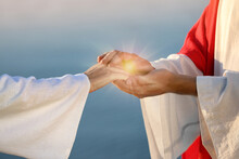Jesus Christ And Woman Near Water Outdoors, Closeup. Miraculous Light In Hands