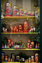 Wooden Matryoshka Dolls In Glass Showcase Cabinet Of Local Souvenirs Gifts Toys Shop For Czechia People And Foreign Travelers Buy Shopping At Old Town At Praha City In Prague, Czech Republic