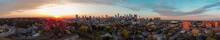 Panoramic Image Of A Suburb Against Calgary's Beautiful Downtown Just In Right Time Of Sunset.