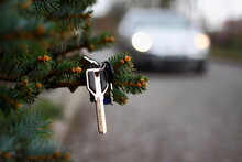 Car Keys On The Branch Of The Christmas Tree.Dreams Come True On New Year's Eve.