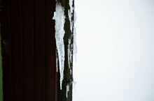 A Big Beautiful Icicle Hanging From The Roof