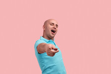 I Chose You As My Companion. Funny Bald Homosexual Man With Bristle Pointed With Forefinger To Camera As Real Star, Calling To Party, Gay Friendly, Wears Blue Polo Shirt, Poses Over Pink Background.