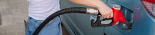 Woman Refueling Car With Gasoline At Self-service Gas Station.