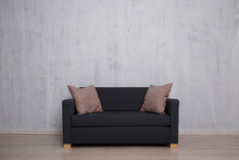 Modern Sofa With Copy Space Over Concrete Wall