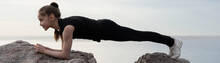 Girl Gymnast Performs Various Acrobatic Exercises On Stones Against The Background Of The Sea. Photo Series.