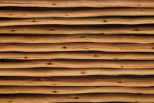 Close Up Abstract View Of Diagonally Slatted Wooden Bamboo Poles Tied Together In A Row To Form A Partition Or A Wall