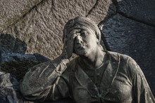 A Sculpture Of Sad Woman In Grief. Virgin Mary Stone Statue (faith, Suffering, Death Concept)