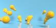Leinwandbild Motiv Scattered light bulbs on a colored background - 3D render