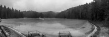 A Panoramic Winter View Of A High Mountain Lake Synevir Located In The Carpathian Mountains, Ukraine. Black And White Shot.
