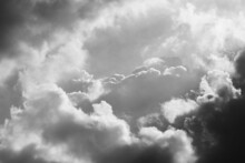 Close Up Of Puffy Clouds In Dark Sky