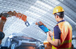 Leinwandbild Motiv Technician or engineer work with robot
