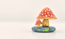 Big And Small Red Mushroom With White Dots On Gray Rock With Moss 3D Illustration