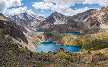 Blue Glacial Lake High In The Mountains. Atmospheric Green Landscape With A Lake In A High-altitude Valley. Altai Mountains.