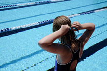 Young Girl Putting Her Googles On For Swimming