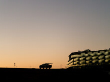 Dusk Silhouette Car And A Hotel On Mt Panorama Racing Circuit