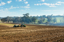 Sowing Crop With Tractor And Combine Seeder