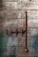Old Wooden Door Detail With Rusted Lock And Paint In The Jewish Ghetto In Rome, Italy