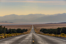 An Empty Highway 50 Disappears Into The Distance In Western Utah