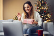 Alone woman at home having Christmas video call with family