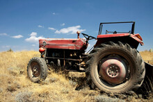 Old Tractor Broken Down And Stuck In The Field