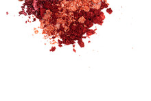 Creative Photo Of Cosmetic Swatches. Broken Eye Shadows In Bronze And Pink Colours On A White Background