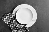 Fototapeta Kawa jest smaczna - Wooden board with plate and stylish napkin on dark background