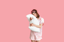 Young Woman Hugging Pillow On Color Background