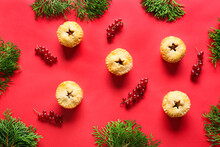Christmas Mince Pies With Cranberry And Fir Branches On Red Background