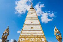 Sri Maha Pho Chedi As The Gleaming Gold And White Chedi With Clear Cloud And Blue Bright Sky Background In Wat Phra That Nong Bua, Ubon Ratchathani, Thailand
