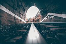 Concept Photo Of A Male Man Walking Through A Dark Tunnel Toward Light