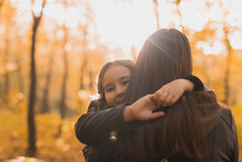 Mother And Daughter Spend Time Together In Autumn Yellow Park. Season And Single Parent Concept.