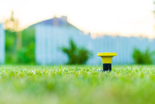 Installing A Mushroom Sprinkler For Watering Freshly Cut Grass In The Lawn