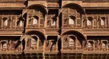 """Traditional Rajasthan Architecture Made Of Yellow Limestone With Intricate Artwork Of Heritage Building """"Patwon Ki Haveli"""" At Jaisalmer India."""