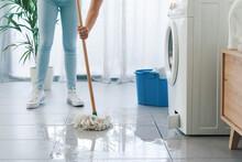 Broken Washing Machine Leaking On The Floor