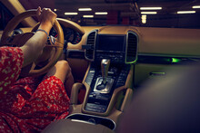 Woman Sitting In Car With Control Panel And Gear Shift