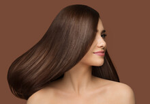 Hair Beauty Model. Brunette Woman With Long Straight Shiny Hairstyle Over Dark Beige Background. Healthy Hair Care