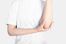 Health Problem, Skin Diseases. Young Woman Scratching Her Itchy Arm With Allergy Rash.