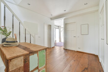 Old Table On Parquet In Modern House