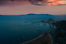 Lateral Aerial View At Sunset Of The Town Of Talamone And In The Background The Argentario Tuscany