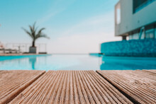 Empty Wooden Deck With Swimming Pool , Beautiful Minimalist Pool Side View With Clear Blue Sky . Vintage Filter Color Apply