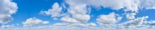 Large Panorama Of Bright Blue Sky With Clouds